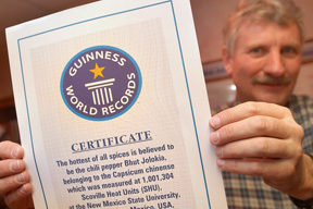 Dr. Paul Bosland with Guinness Record Certificate